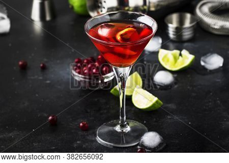 Cosmopolitan Cocktail With Vodka, Liqueur, Cranberry Juice, Lime, Ice And Orange Zest, Gray Bar Coun