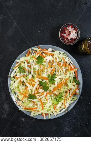 White Cabbage Salad Coleslaw With Carrot On Grey Kitchen Table Background. Top View, Copy Space