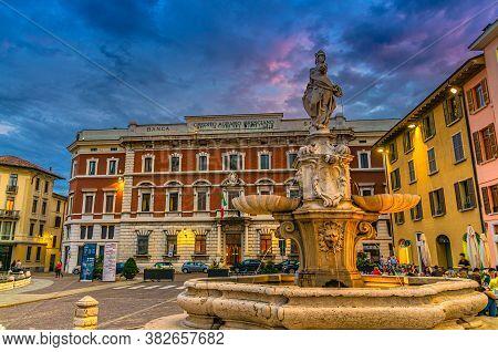 Brescia, Italy, September 10, 2019: Fountain, Street Restaurant And Credito Agrario Bresciano Bank B