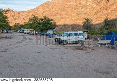 Ai-ais, Namibia - June 17, 2011: View Of The Camping Area At Ai-ais. A Caravan, Vehicles And Tents A