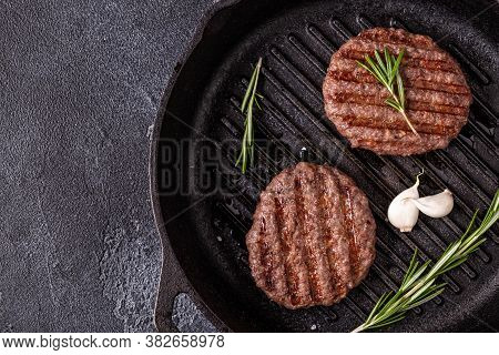 Fried Cutlet For Burger With Spices On Grill Pan, Top View, Copy Space.