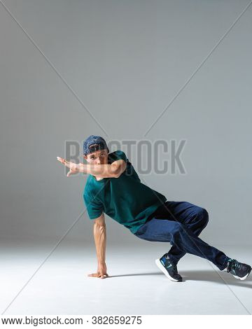 Cool Guy Breakdancer Dancing Lower Break Dance Isolated On Gray Background. Break Dance Lessons