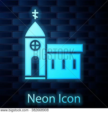 Glowing Neon Church Building Icon Isolated On Brick Wall Background. Christian Church. Religion Of C