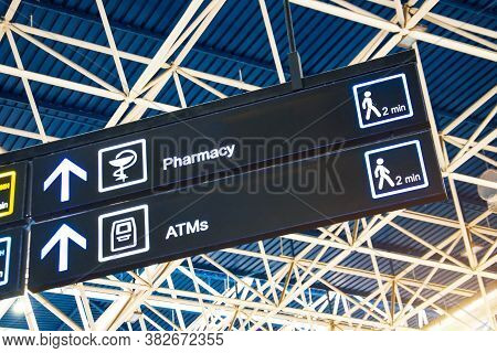 Directions On The Sign At The Airport - Pharmacy And Atm