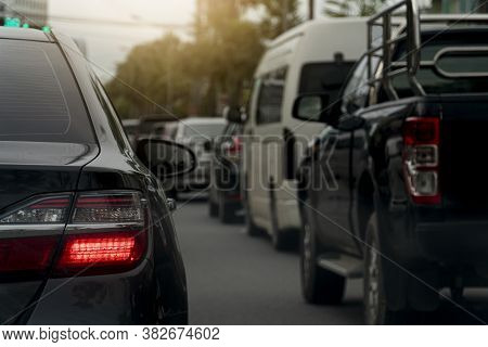 Turn Light Of Car On Asphalt Road. Traffic Jams In The Evening With Other Cars.