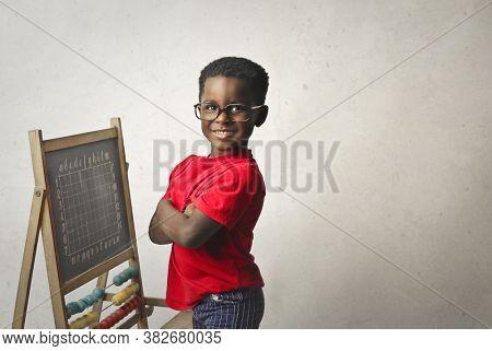 portrait of black child with small blackboard