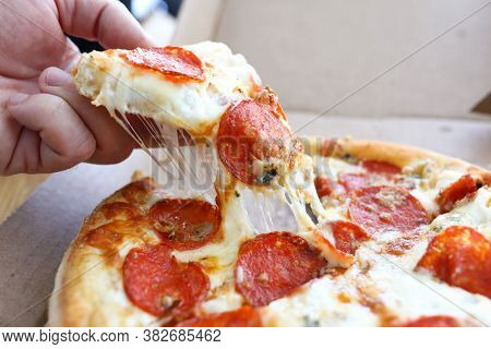Hand Takes Slice Whole Hot Cheese Pizza From Box. Ordering Pizza For Home Delivery. Use Quality Prod