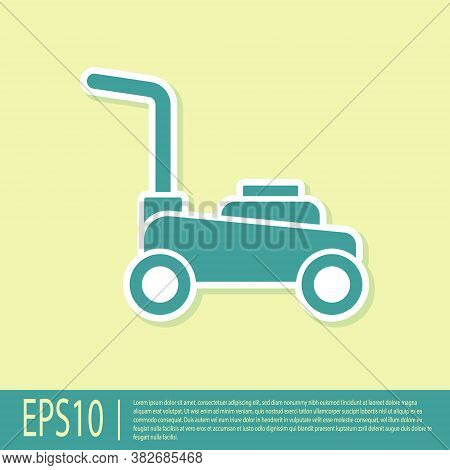 Green Lawn Mower Icon Isolated On Yellow Background. Lawn Mower Cutting Grass. Vector