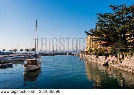 Sirmione, Brescia, Italy - December 2015: Small Tourist Port With Private Boats On Garda Lake, Sirmi