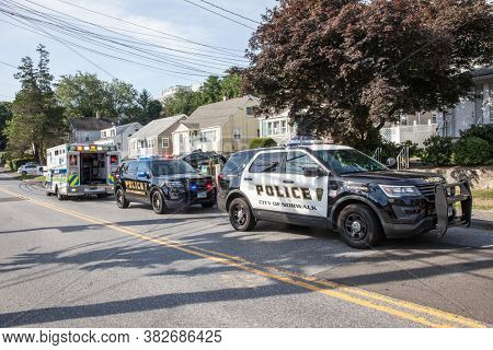 NORWALK, CT, USA -JULY 30, 2020:  Police and ambulance cars parking on Taylor Ave