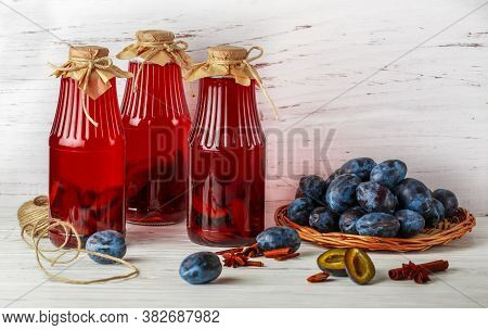 Homemade Plum Compote With Cinnamon And Star Anise. Delicious Healthy Vitamin Drink. Jars And Fresh