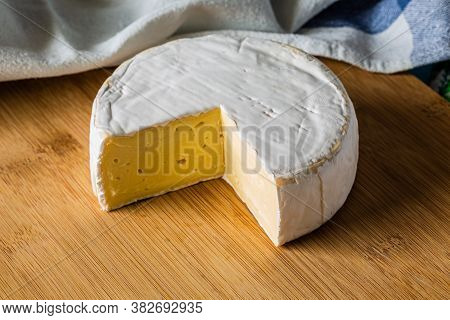 Fresh Brie Cheese Without Cut Slice On Wooden Board