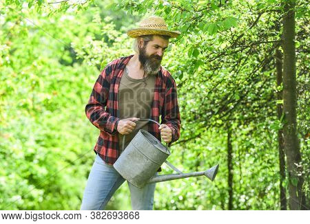 Caucasian Farmer Countryside Nature Background. Garden Tools Every Gardener Should Have. Look After