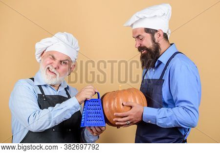 Teaching Culinary. Culinary Book. Mature Bearded Men Professional Restaurant Cooks. Culinary Recipe.
