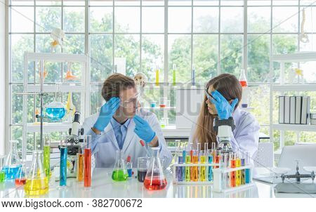 Stressed Unsuccessful Western Scientists Couple Working Failed On Test Tube To Analysis And Develop
