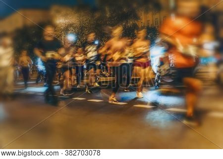 Large Group Of Running Athletes On Street, Night City Marathon, Blur Effect, Unrecognizable Peole. S