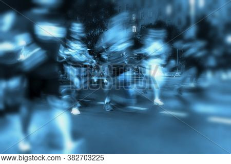 Motion Blurred Image Of Running Athletes. Silhouettes Of Abstract Unrecognizable People, Night City,