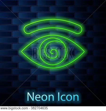 Glowing Neon Line Hypnosis Icon Isolated On Brick Wall Background. Human Eye With Spiral Hypnotic Ir