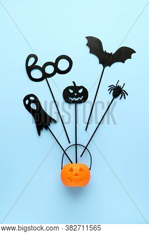 Happy Halloween Day Concept. Top View Halloween Party Accessories And Jack-o-lantern Pumpkin On Past