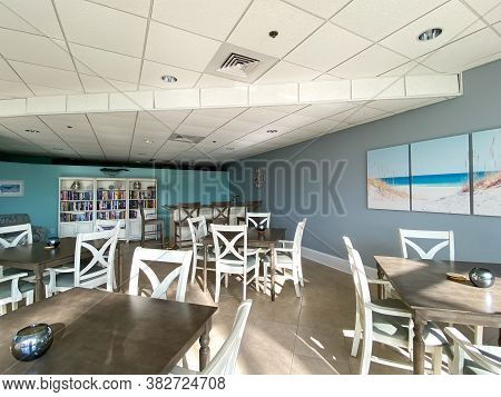 A Condominium Party Room Decorated In A Beach Theme