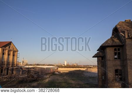 Abandoned Factories And Warehouses With Their Distinctive Chimneys In Eastern Europe, In Pancevo, Se