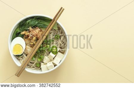 Miso Ramen Asian Noodles With Egg, Tofu, And Pak Choi Cabbage In Bowl. Japanese Cuisine. Top View, C