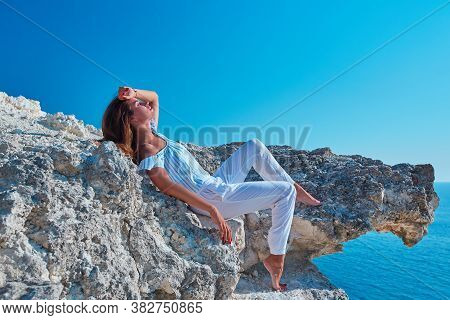 Relaxation Or Contemplation. Yoga Time. Female Laying On Hill. Sunbathing. Virgin Nature. Meditation