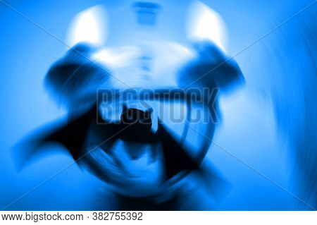 Silhouette Of A Mystical Bat On A Twilight Blue Background With A Radial Blur. Close Up