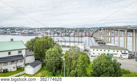 View On The Bridge From The Arctic Cathedral To The Center Of Tromso In Norway