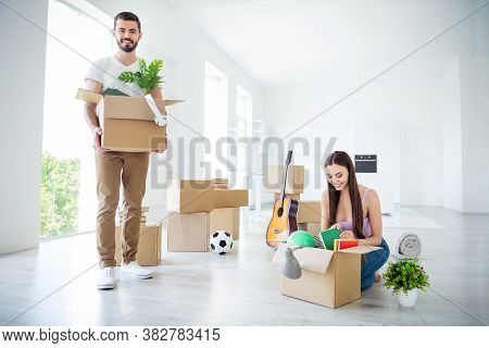 Portrait Of His He Her She Nice Attractive Lovely Cheerful Cheery Couple Packing Unpacking Stuff Unw