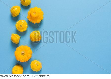 Fresh Harvest Of Zucchini And Pattypan Squash, Yellow Squash And Pattison On Blue Background