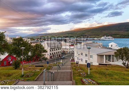 Akureyri, Iceland - August 8, 2012: Dramatic Sky Over Akureyri Center At Dusk. Akureyri, Called The