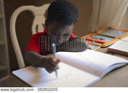 sad child does school homework