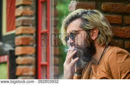 Take A Puff. Business Man In Glasses Smoking Cigarette On Street. Go Out For Smoke Break. Handsome S