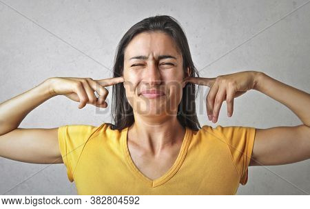 young woman annoyed by a noise