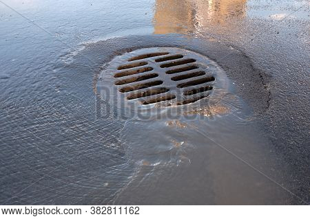 Round Metal Sheet On The Drainage Hole, Drainage Hole After Rain. For Flood Protection Within The Re