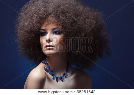 beauty woman with curly hair and blue make-up