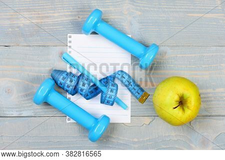 Blank Page And Gym Equipment In Cyan Blue, Top View