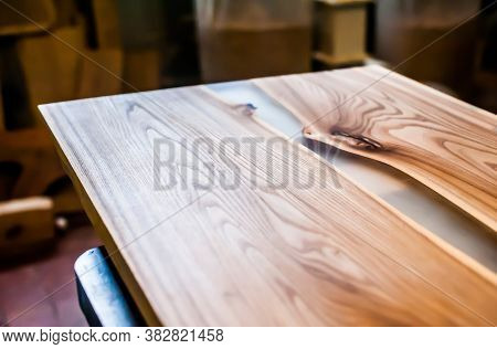 Epoxy-painted Solid Wood Table Top Close-up In A Carpentry Workshop. Wood Texture