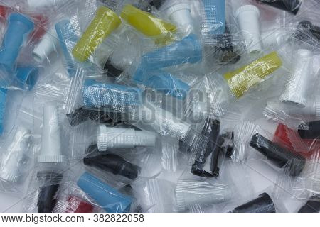 Multicolored Disposable Mouthpieces For Hookah On White Background. Close-up. Accessories For Hookah