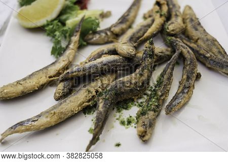 Plate Of Fried Anchovies In Batter With Lemon And Parsley Delicious Fish Typical Gastronomic Dish Of