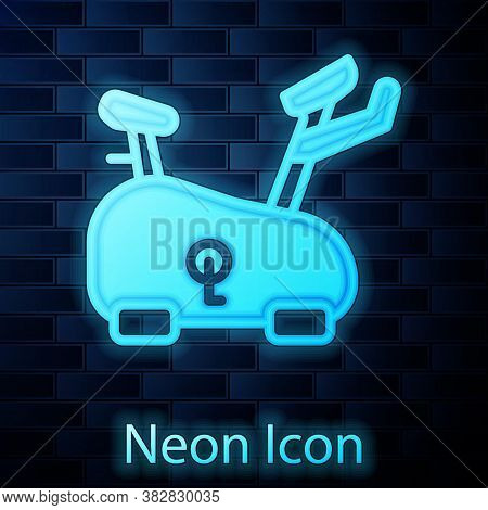 Glowing Neon Stationary Bicycle Icon Isolated On Brick Wall Background. Exercise Bike. Vector