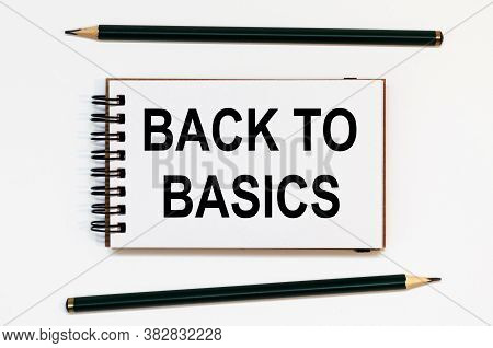 White Spiral Notebook, Two Pencils With Text Back To Basics
