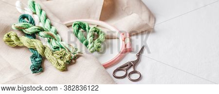 Set For Embroidery. Linen Fabric, Patterns For Embroidery, Hoop, Green Thread And Needles. Copy Spac