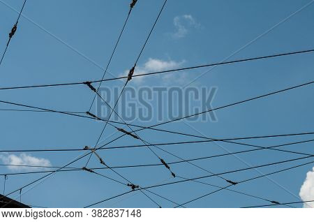 Steel Cables Of An Overhead Power Line For Streetcars At Blue Sky