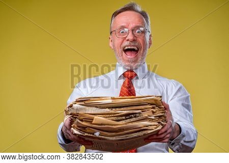Pile Of Documents In Hands. Senior Man Holdind Piles Of Documents Paper Work. Surprised Of Hard Ment