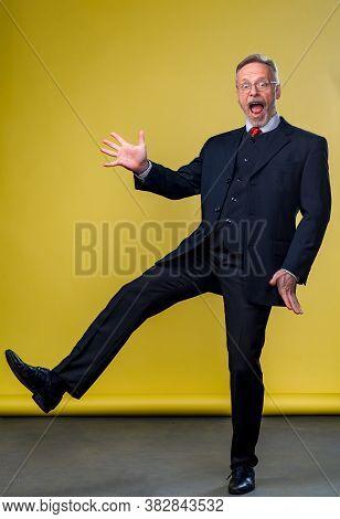 Senior Man Looking At Camera While Making Silly Face. Funny Pose. Waving To The Camera