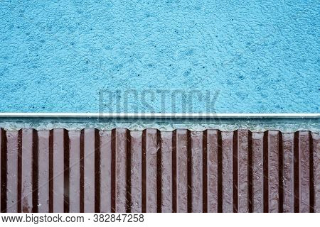 Gutter On A Roof At The Time Of Rain, Storm Drain. Gutter System, Copy Space, Top View