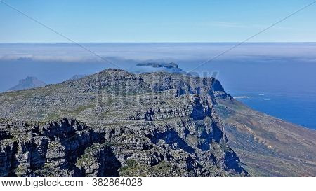 Alpine Landscape Of South Africa. On The Flat Summit Of Table Mountain There Are Gray Stones. The Cl