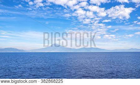 Fuji Mountain Landscape View Over Blue Sky And White Cloud From The Ferry Boat In The Ocean At Surug